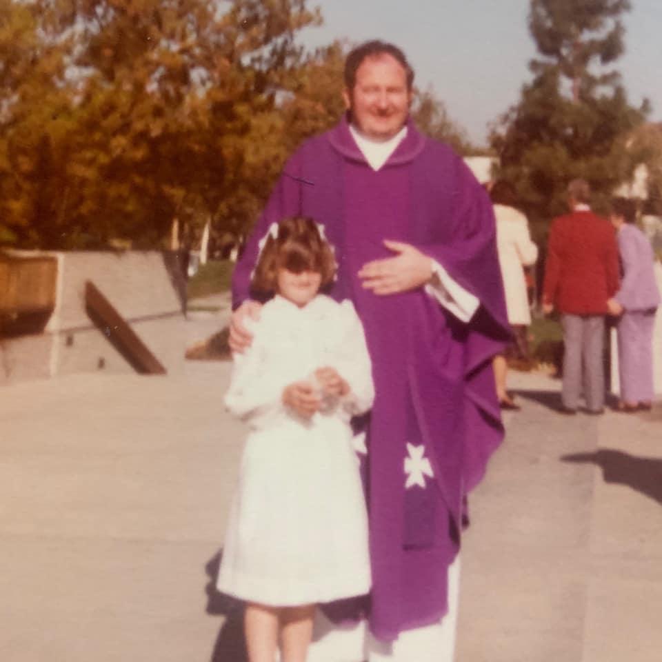 Kathryn Cloward First Communion with Father Joe