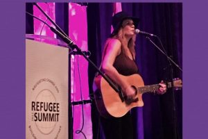Kathryn Cloward Performing at the Refugee Summit